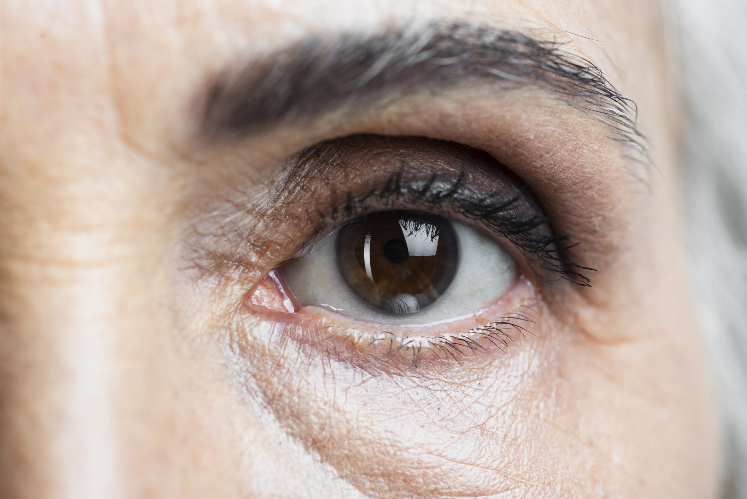 Close-up of an older woman's eye for a glaucoma test