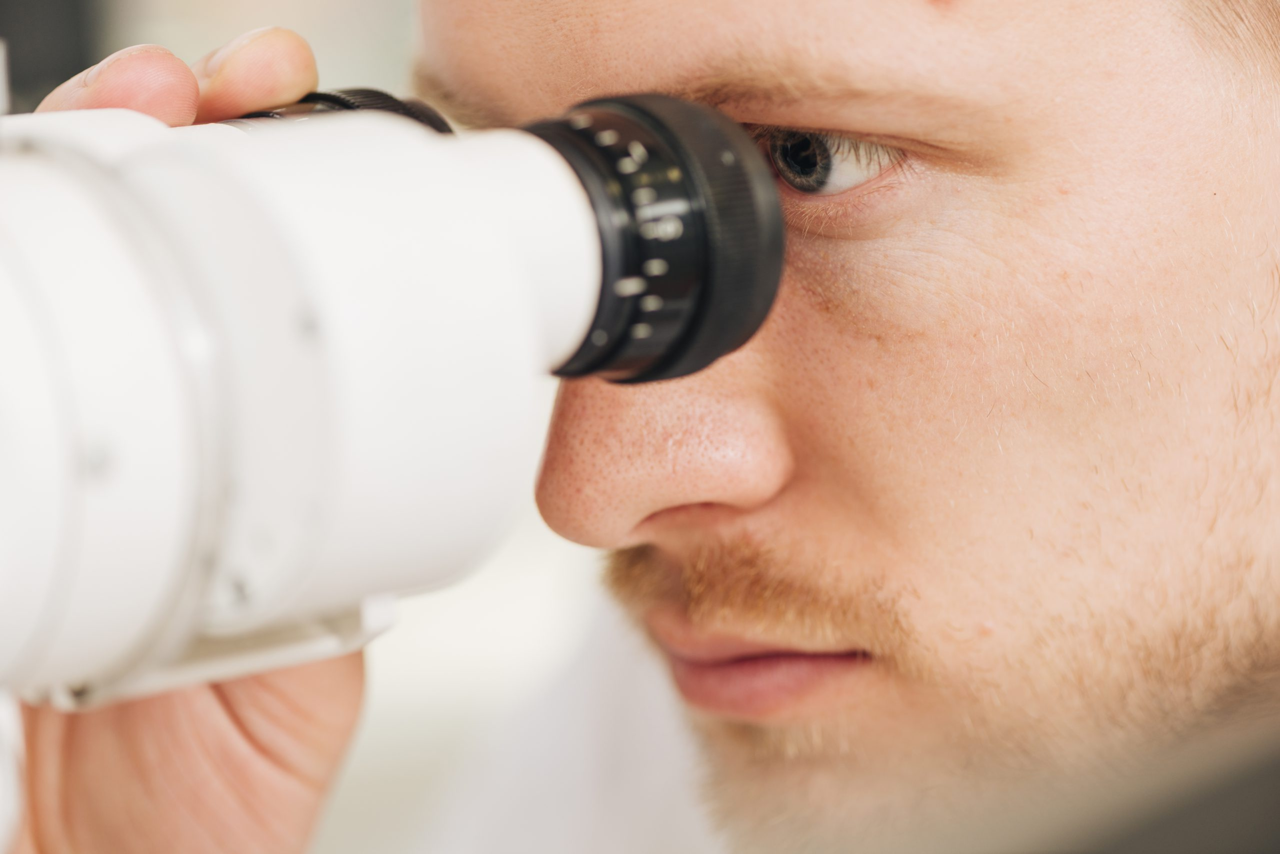 Male optometrist checking for signs of glaucoma