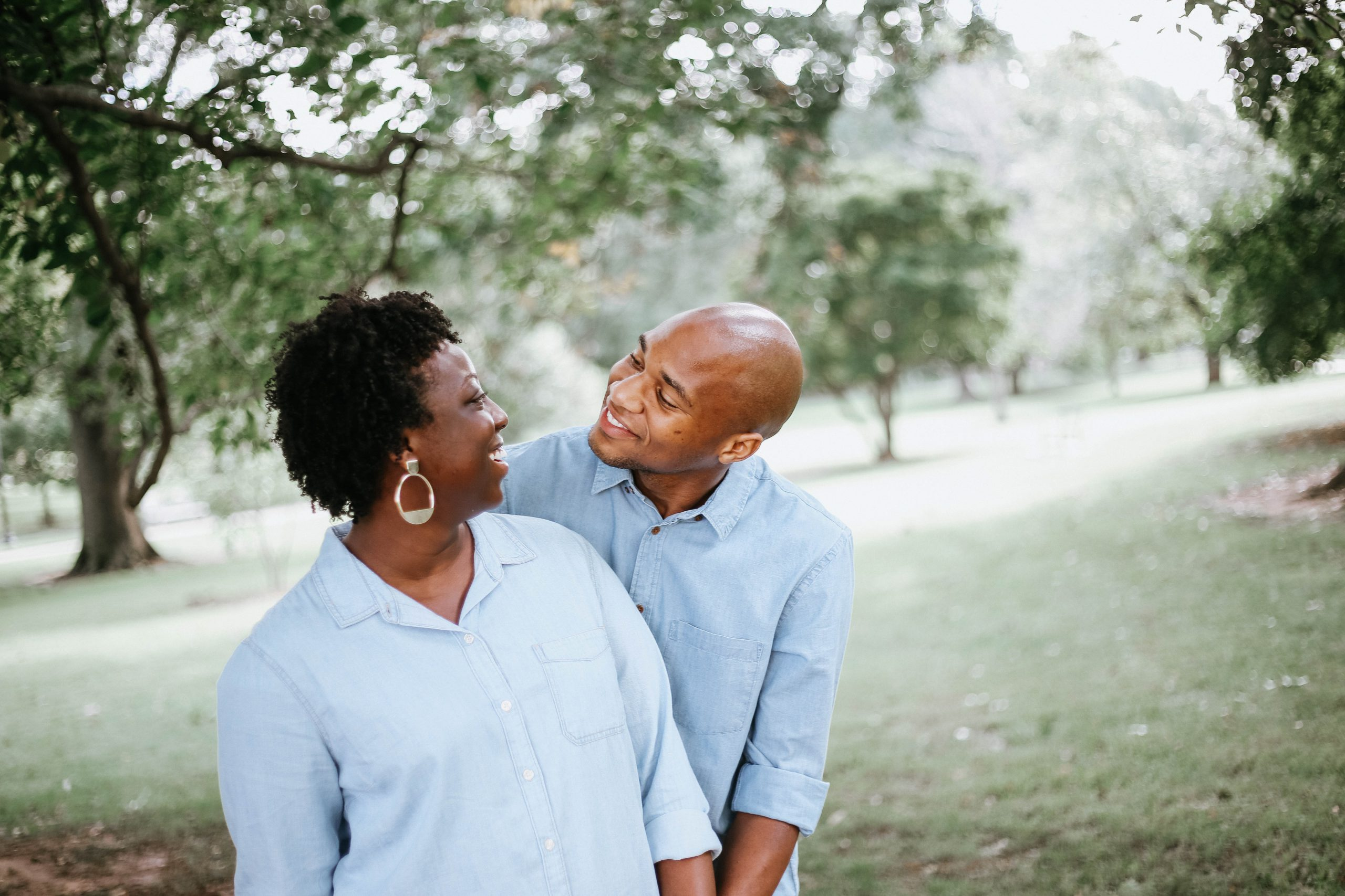 Middle age black couple smiling and holding one another at risk for glaucoma