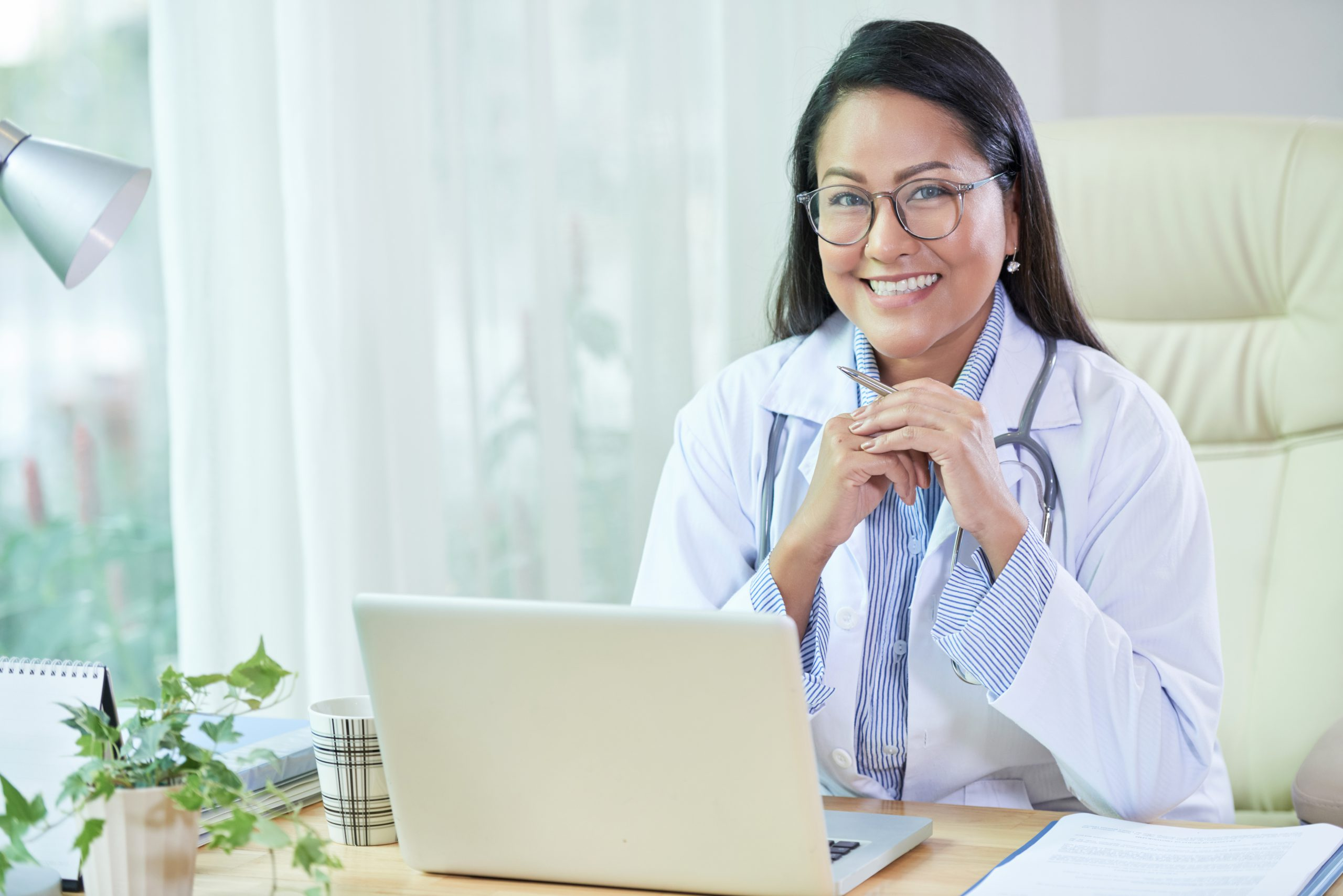 Smiling female gynecologist ready for fibroids patient appointment