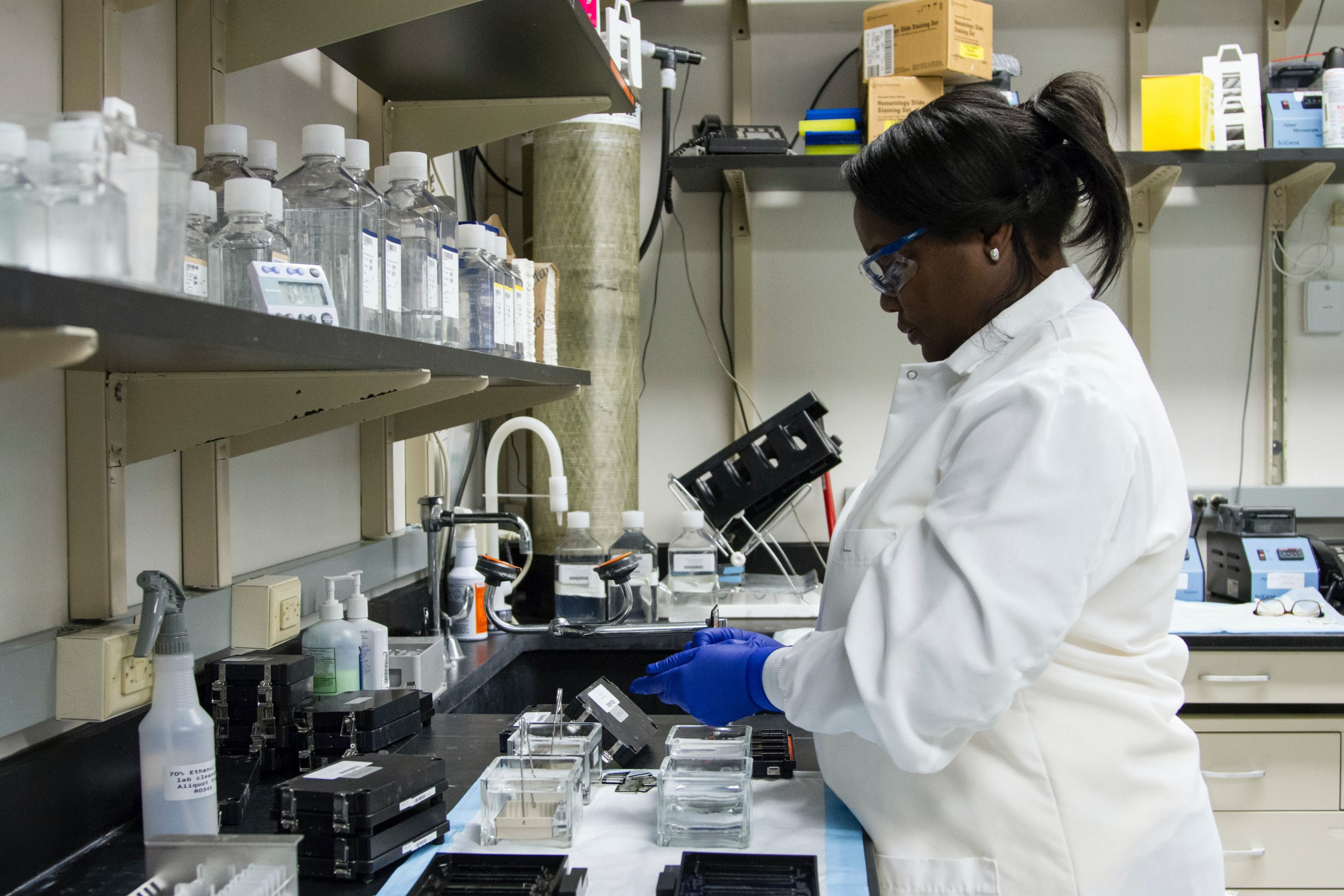 Black female scientist in lab doing fibroids research