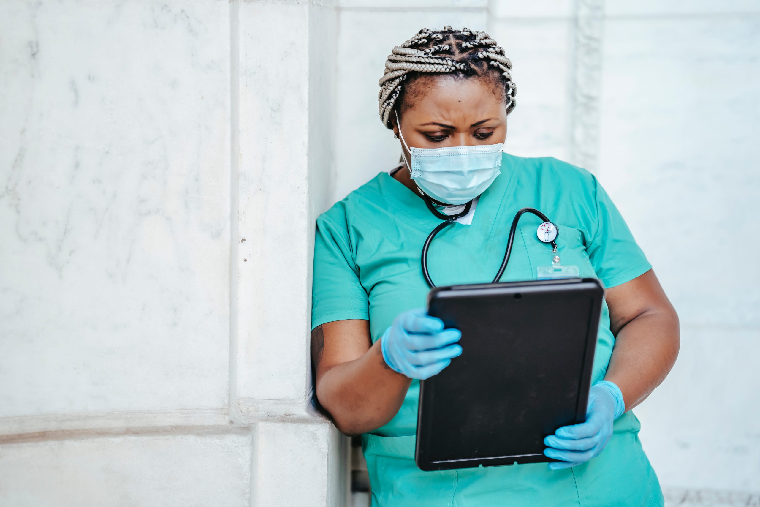 Doctor examines patient chart for COVID-19 lung damage